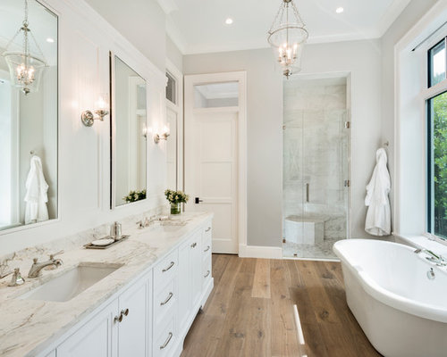 country master gray tile medium tone wood floor and beige floor bathroom photo in miami with