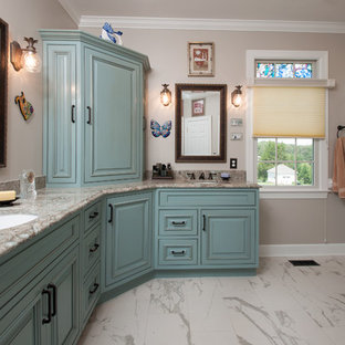 This is an example of a large mediterranean ensuite bathroom in DC Metro with raised-panel cabinets, blue cabinets, a built-in bath, a corner shower, a submerged sink, engineered stone worktops and a hinged door.