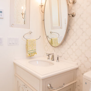 This is an example of a large mediterranean family bathroom in Vancouver with a submerged sink, flat-panel cabinets, white cabinets and marble flooring.