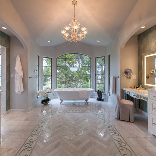Inspiration for a large mediterranean master marble floor and gray floor claw-foot bathtub remodel in Hawaii with raised-panel cabinets, white cabinets, green walls, an undermount sink and gray countertops