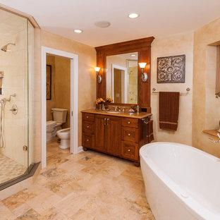 Elegant stone tile freestanding bathtub photo in Milwaukee