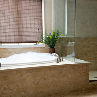 Example of a mid-sized tuscan master beige tile and porcelain tile porcelain floor bathroom design in Bridgeport with an undermount sink, raised-panel cabinets, medium tone wood cabinets, engineered quartz countertops, a two-piece toilet and beige walls