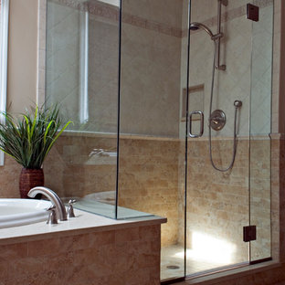 Inspiration for a medium sized mediterranean ensuite bathroom in Bridgeport with a submerged sink, raised-panel cabinets, medium wood cabinets, engineered stone worktops, a built-in bath, a shower/bath combination, a two-piece toilet, beige tiles, porcelain tiles, beige walls and porcelain flooring.