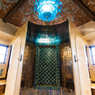 This is an example of a medium sized mediterranean ensuite bathroom in Austin with a built-in bath, brown tiles, green tiles, multi-coloured tiles, metal tiles and beige walls.