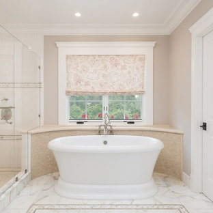 Tuscan master multicolored tile and stone tile medium tone wood floor bathroom photo in San Francisco with recessed-panel cabinets, yellow cabinets, a two-piece toilet, beige walls, an undermount sink and quartzite countertops