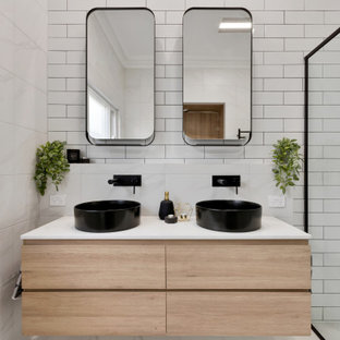 Mid-sized contemporary 3/4 bathroom in Adelaide with flat-panel cabinets, light wood cabinets, an alcove shower, white tile, subway tile, a vessel sink, white floor, a sliding shower screen, white benchtops and a built-in vanity.