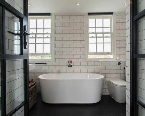 this is an example of a traditional bathroom in london with a freestanding bath a