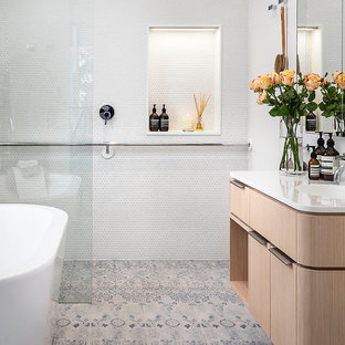 Example of a trendy master white tile and mosaic tile bathroom design in Melbourne with flat-panel cabinets, light wood cabinets, white walls and an integrated sink