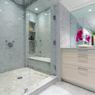 Large trendy gray tile gray floor bathroom photo in New York with shaker cabinets, white cabinets, a vessel sink, a hinged shower door, gray countertops and a niche