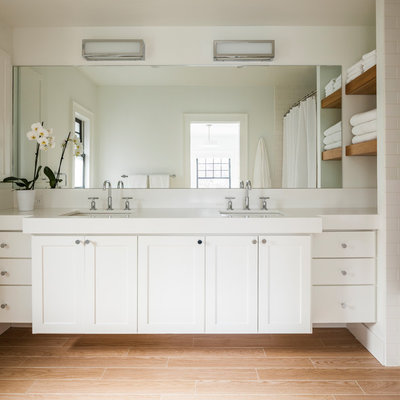 Example of a mid-sized transitional master white tile and ceramic tile light wood floor and beige floor alcove bathtub design in Seattle with shaker cabinets, white cabinets, white walls and an undermount sink