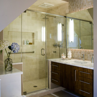 Example of a minimalist beige tile and matchstick tile alcove shower design in Chicago with flat-panel cabinets and dark wood cabinets
