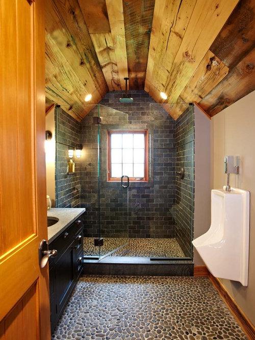 Bathroom - traditional slate tile pebble tile floor bathroom idea in New  York with an urinal