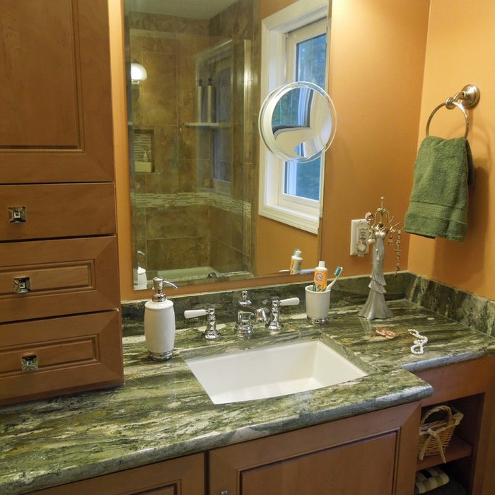 Maple master bathroom remodel with marble touches and natural granite