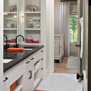 Inspiration for a medium sized rustic family bathroom in Calgary with a built-in sink, white cabinets, concrete worktops, white tiles, ceramic tiles, beige walls and ceramic flooring.