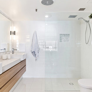 Photo of a contemporary 3/4 bathroom in Gold Coast - Tweed with flat-panel cabinets, brown cabinets, a corner shower, a two-piece toilet, white tile, white walls, a vessel sink, white floor and an open shower.