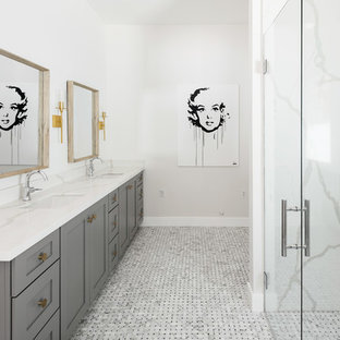 Inspiration for a large transitional master white tile and marble tile gray floor and marble floor bathroom remodel in Phoenix with shaker cabinets, gray cabinets, white walls, an undermount sink, a hinged shower door, a two-piece toilet, laminate countertops and white countertops