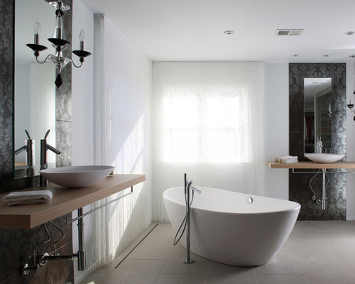 example of a minimalist bathroom design in dc metro with a freestanding tub and a vessel
