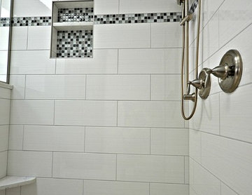 Updated tile with glass accents and glass tile niche.