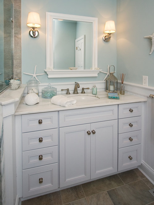 Example Of A Coastal Beige Tile Bathroom Design In New York With An  Undermount Sink,