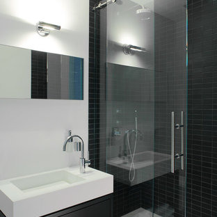 Design ideas for a contemporary bathroom in New York with open cabinets, an alcove shower, black tile, ceramic tile, an integrated sink and black cabinets.