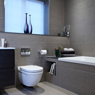 Example Of A Trendy Bathroom Design In London With A Wall Mount Toilet