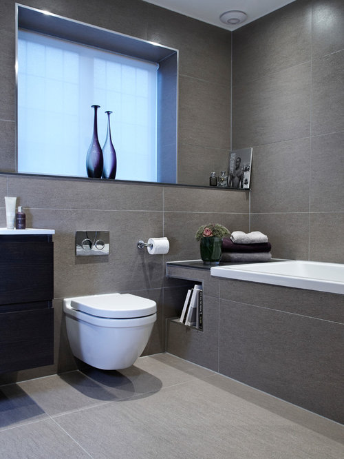 Inspiration for a contemporary bathroom in london with a wall mounted toilet