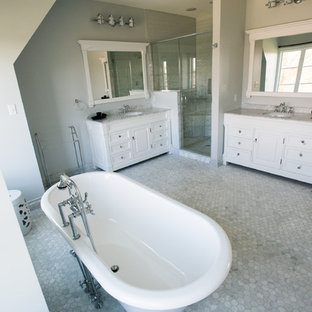 Design ideas for a large traditional master bathroom in Other with raised-panel cabinets, white cabinets, a freestanding tub, an open shower, a one-piece toilet, gray tile, white tile, stone tile, green walls, terra-cotta floors, a drop-in sink and soapstone benchtops.