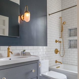 Example of a transitional white tile and subway tile blue floor bathroom design in New York with flat-panel cabinets, gray cabinets, blue walls and a console sink