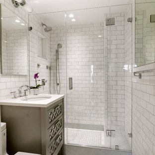 Example of a small classic master white tile and subway tile mosaic tile floor alcove shower design in New York with furniture-like cabinets, gray cabinets, a one-piece toilet, gray walls, an undermount sink and engineered quartz countertops