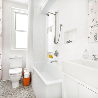 Small trendy 3/4 subway tile and white tile mosaic tile floor and gray floor bathroom photo in New York with white walls, flat-panel cabinets, white cabinets and a console sink