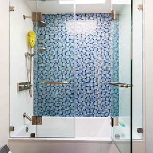 Bathroom - mid-sized transitional 3/4 blue tile and mosaic tile bathroom idea in New York with a one-piece toilet, white walls and a hinged shower door