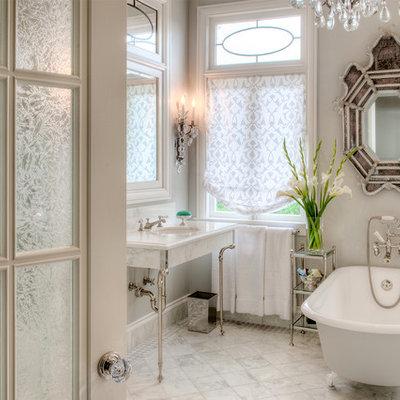 Claw-foot bathtub - traditional white tile claw-foot bathtub idea in San Francisco with a console sink