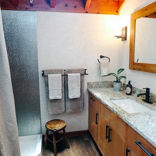 Ispirazione per una piccola stanza da bagno con doccia rustica con ante con riquadro incassato, ante in legno scuro, doccia ad angolo, piastrelle in metallo, pavimento in vinile, top in granito, doccia con tenda e top bianco