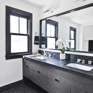На фото: маленькая главная ванная комната в современном стиле с плоскими фасадами, коричневыми фасадами, угловым душем, раздельным унитазом, белой плиткой, терракотовой плиткой, белыми стенами, полом из известняка, врезной раковиной, столешницей из гранита, черным полом, душем с распашными дверями и черной столешницей с