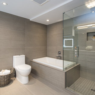 Design ideas for a mid-sized contemporary master bathroom in Vancouver with flat-panel cabinets, white cabinets, a drop-in tub, an open shower, brown tile, porcelain tile, brown walls, porcelain floors, engineered quartz benchtops, beige floor, a hinged shower door, white benchtops, a niche, a double vanity, a freestanding vanity and panelled walls.