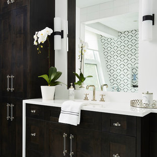 Inspiration for a transitional master white floor bathroom remodel in Minneapolis with dark wood cabinets, a hinged shower door, white countertops, shaker cabinets and white walls