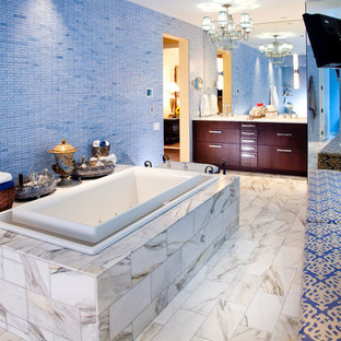 Drop-in bathtub - eclectic blue tile and mosaic tile drop-in bathtub idea in Chicago with flat-panel cabinets and dark wood cabinets