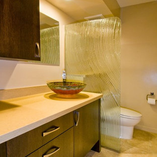 Trendy bathroom photo in Hawaii with solid surface countertops and a vessel sink