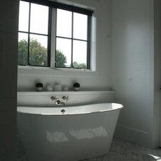 Farmhouse Bathroom by ENJOY Co.