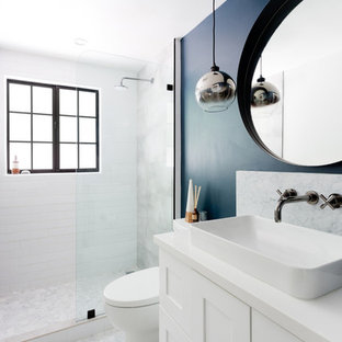 Small transitional 3/4 gray tile, white tile and marble tile marble floor and gray floor bathroom photo in Los Angeles with shaker cabinets, white cabinets, a one-piece toilet, blue walls, a vessel sink, engineered quartz countertops and white countertops