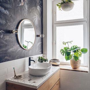 Esempio di una stanza da bagno minimal con ante lisce, ante in legno scuro, piastrelle bianche, piastrelle diamantate, pareti nere, lavabo a bacinella, pavimento grigio e top bianco