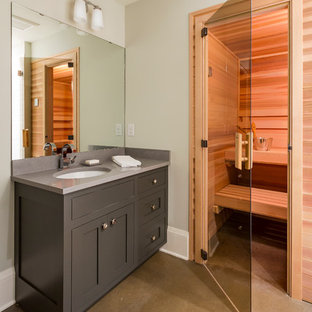 Mid-sized transitional concrete floor and brown floor sauna photo in Minneapolis with shaker cabinets, gray cabinets, gray walls and an undermount sink