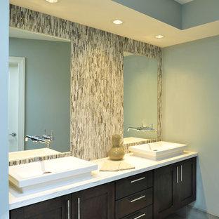 Inspiration for a transitional beige tile bathroom remodel in Nashville with a vessel sink, shaker cabinets and dark wood cabinets