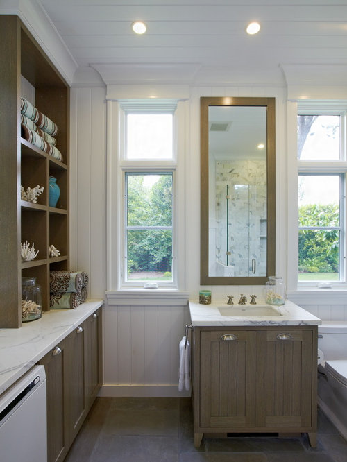... with an undermount sink, shaker cabinets and medium tone wood cabinets