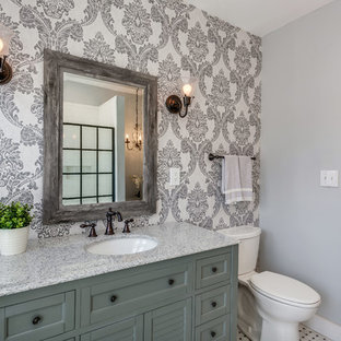 Inspiration for a transitional 3/4 white tile and subway tile bathroom remodel in Detroit with shaker cabinets, green cabinets, a two-piece toilet, blue walls, an undermount sink and gray countertops