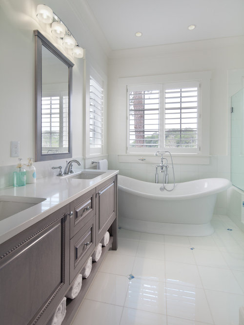 beach style white tile freestanding bathtub idea in dc metro with an undermount sink raised