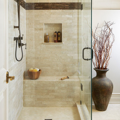 Inspiration for a transitional beige tile bathroom remodel in Toronto with a niche