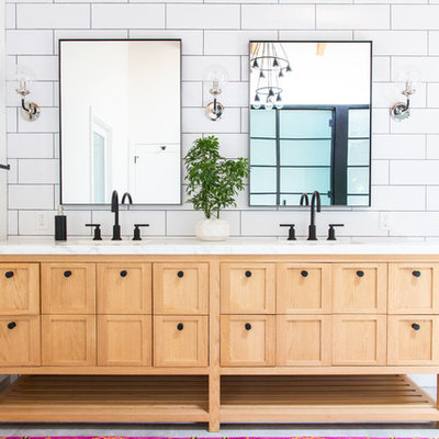 Inspiration for a transitional master white tile and subway tile bathroom remodel in Los Angeles with furniture-like cabinets, light wood cabinets, white walls and white countertops