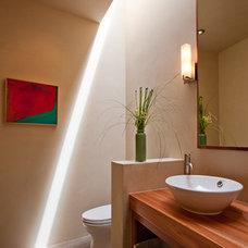 Southwestern Bathroom by Archaeo Architects