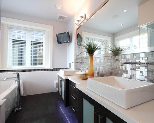 Contemporary Black Floor Freestanding Bathtub Idea In Vancouver With A  Vessel Sink